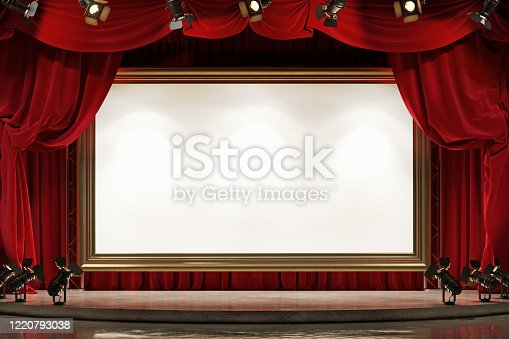 939154550 istock photo A large picture frame on the theater stage with blue velvet curtains. 1220793038