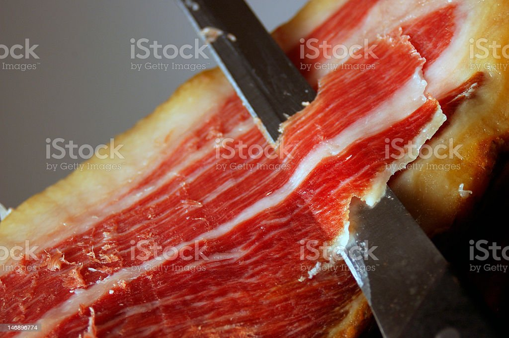 A large piece of Jamon iberico ham from Spain stock photo