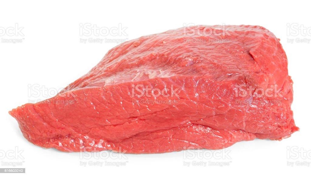 Un gran pedazo de carne cruda es aislado en blanco. - foto de stock