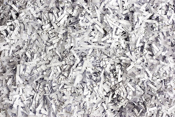 a large pile of black and white shredded paper pieces - shredded paper stock photos and pictures