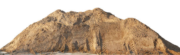 A large pile of construction sand with traces of tractor wheels. stock photo