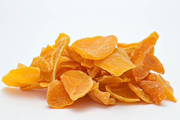 large pile of dried up mango. - dried food stock photos and pictures