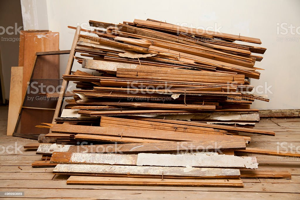 large pile of hardwood floor during construction