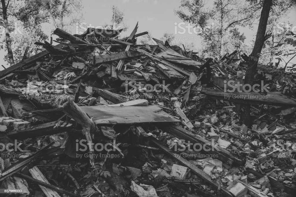 Large pile of rubbish, debris of a building, ruined house, can be used as consequences of war, earthquake, hurricane or other natural disaster stock photo