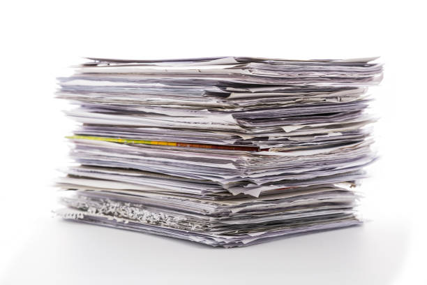Large pile of waste paper isolated on white. Ready for recycling stock photo