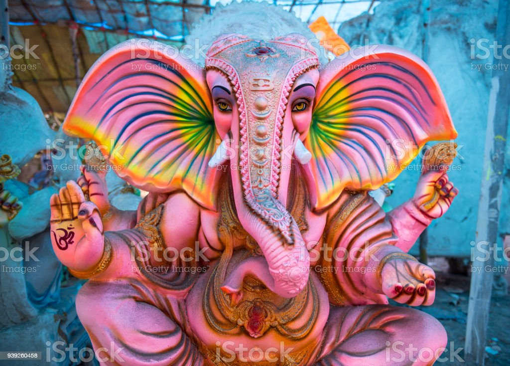Large pink Ganesha statue- brightly colored stock photo