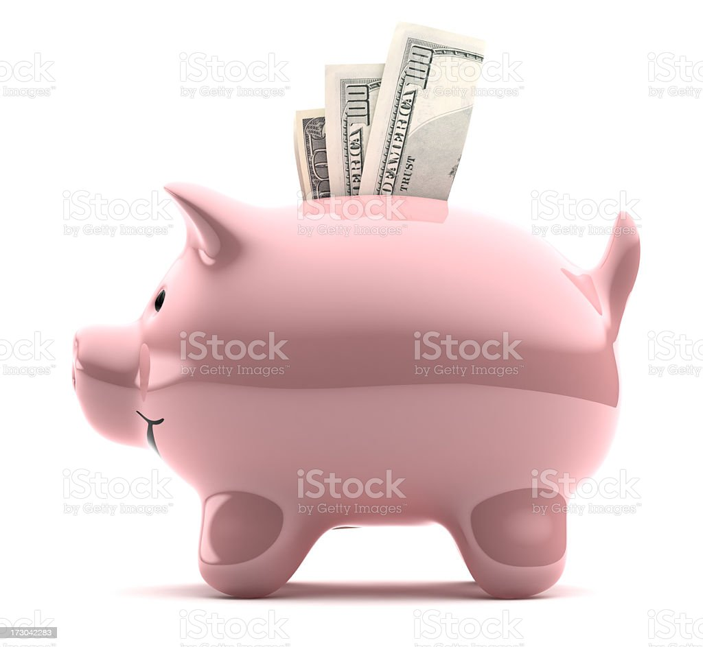 Large pink piggy bank filled with notes royalty-free stock photo