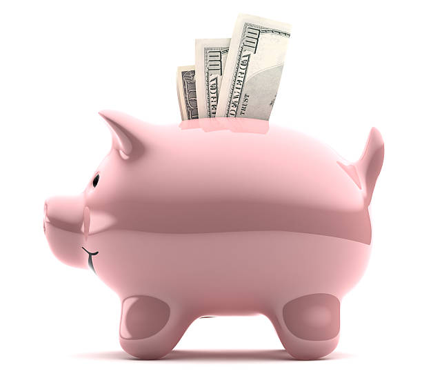 Large pink piggy bank filled with notes stock photo