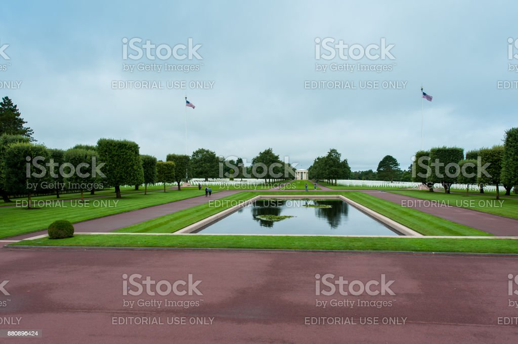 Large pond and American flags on the Normandy American Cemetery stock photo