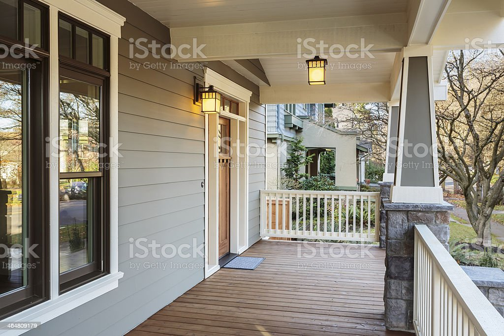 Large porch exterior of an upscale home with lights stock photo