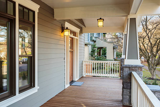 large porch exterior of an upscale home with lights - front view stock photos and pictures