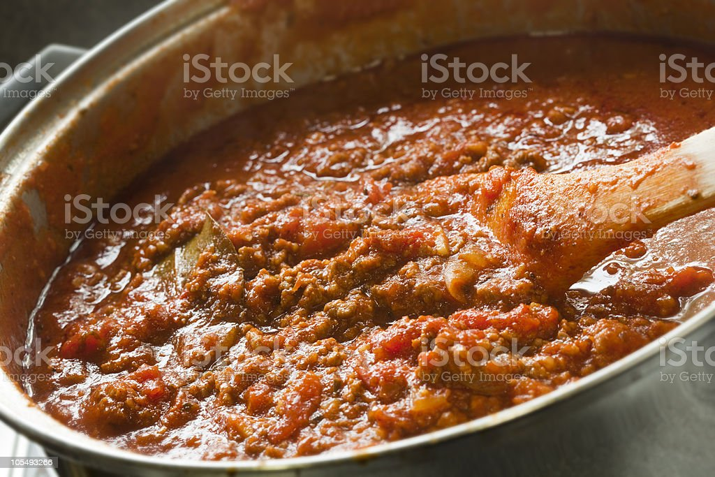 Large pot of Bolognese sauce cooking stock photo