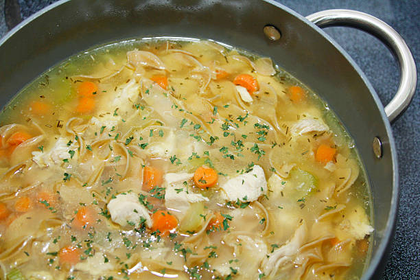 Large pot of homestyle chicken noodle soup stock photo