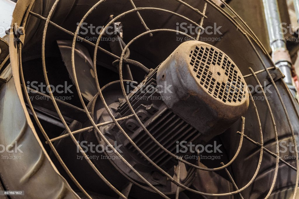 Large powerful industrial electric fan close-up stock photo