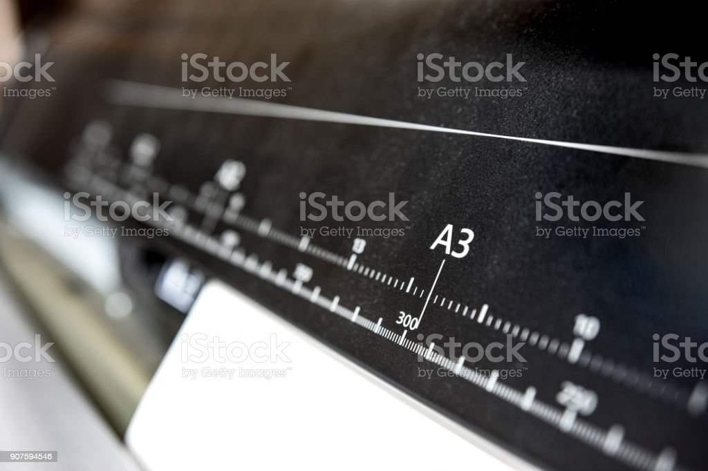 Large print plotter with ruler of paper size selective focus on a3 large print plotter with ruler of paper size selective focus on a3 format royalty malvernweather Image collections