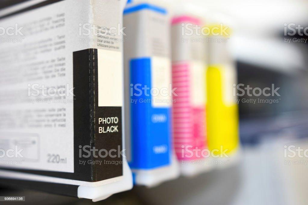Large printer format inkjet cartriges detail black, cyan, magenta, yellow color stock photo