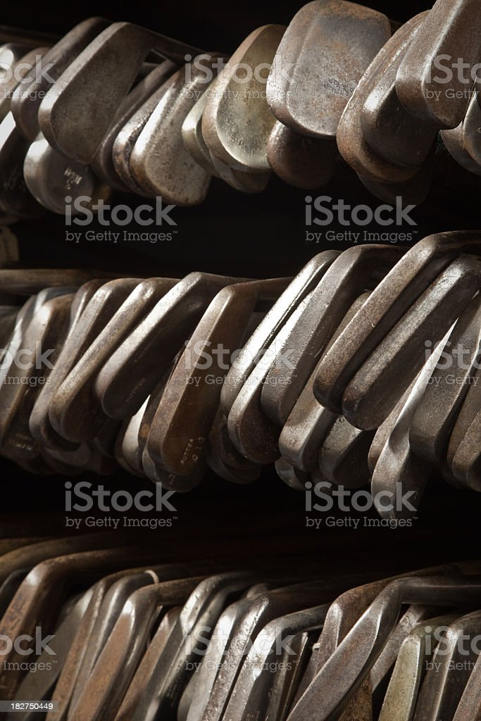large rack of antique hickory shafted golf clubs stock photo