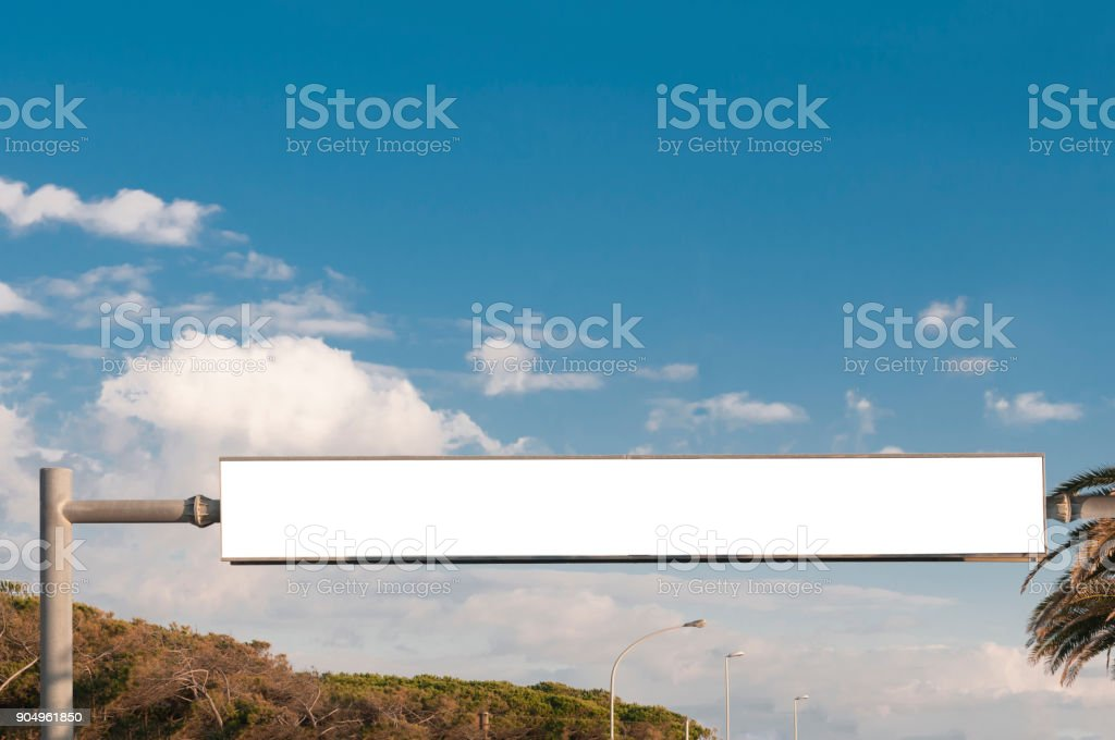 Large rectangular blank billboard crossing the street stock photo