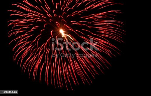 Large Red Fireworks Burst Stock Photo & More Pictures of Backgrounds