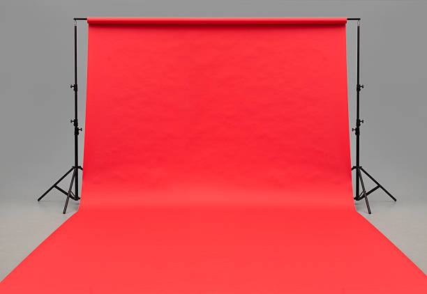 large red paper rolled onto the floor - studio shot stock photos and pictures