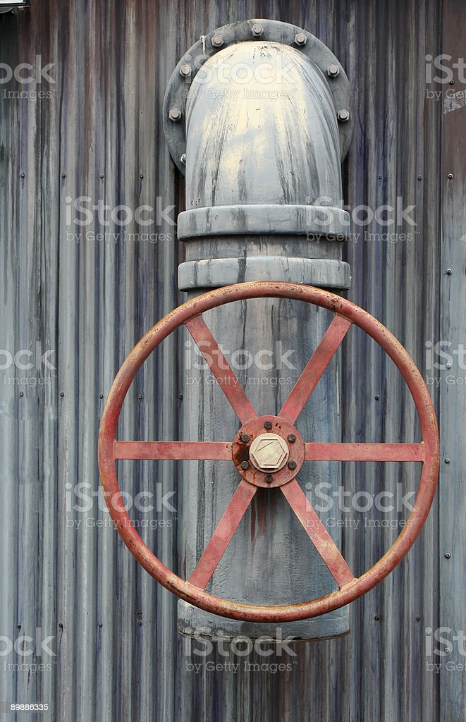 Large red wheel valve with pipe royalty free stockfoto