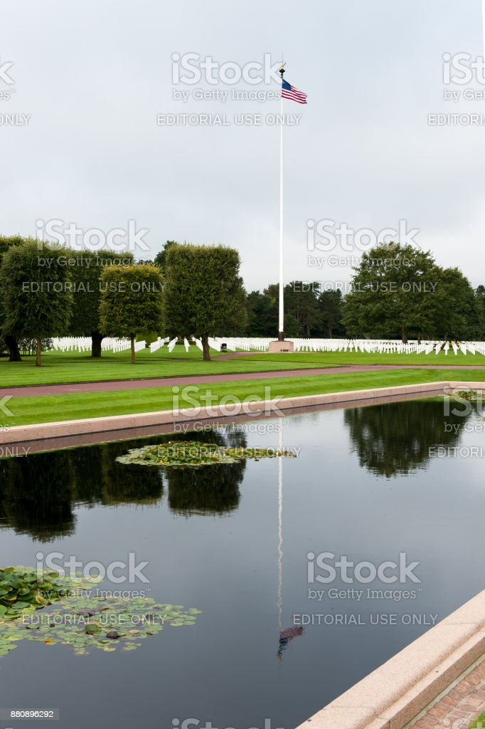 Large reflecting pond and stars and stripes at the Normandy American Cemetery stock photo