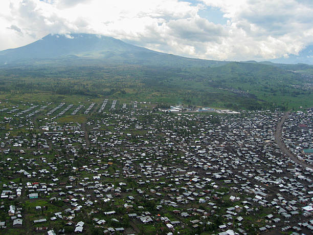 large refugee camp near goma republic of congo and volcano - democratic republic of the congo stock photos and pictures