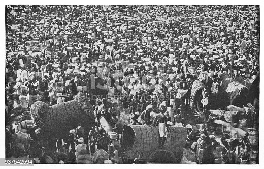 Huge crowd of people at a religious festival in Agra, India during the british era. Vintage halftone circa late 19th century.