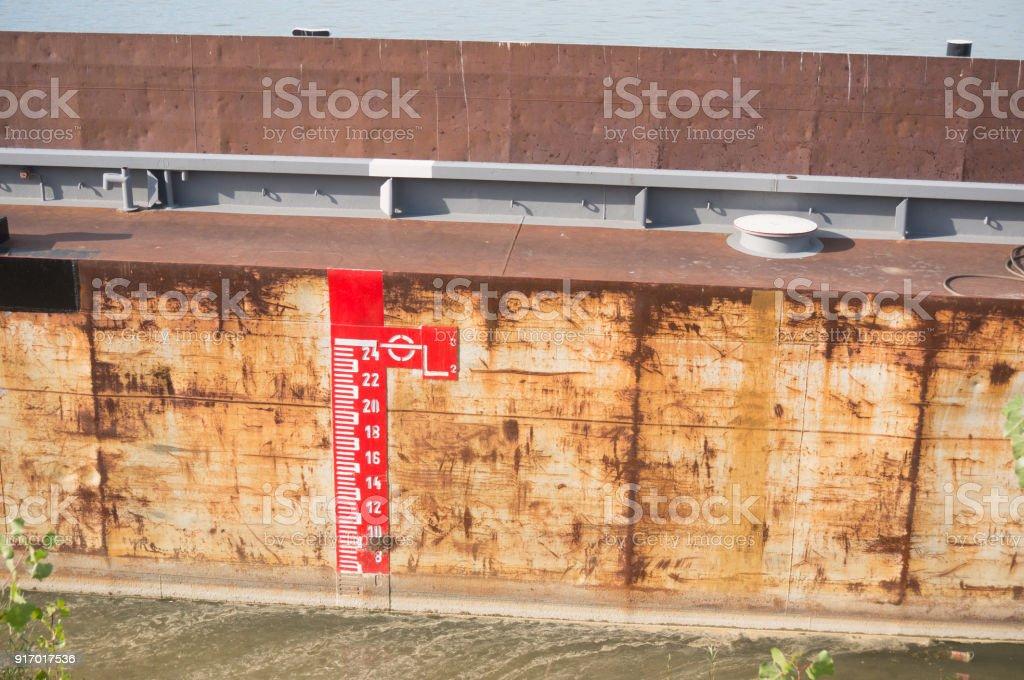 large rive barge depth meter stock photo