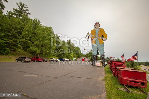 Iron Mountain, Michigan, USA - July 7, 2019: Large roadside statue at the Iron Mountain Iron Mine which now operates as a tourist attraction. and offers underground tours of the mine. The mine supplied Midwest steel companies with iron for 68 years