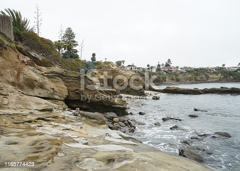 Large rock cliff by an inlet near La Jolla California