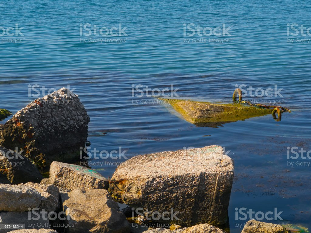 Large rocks and seaweed in the sea royalty-free stock photo