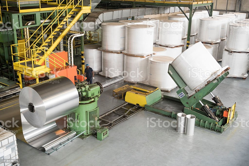 Large rolls of aluminium on machinery, high angle stock photo