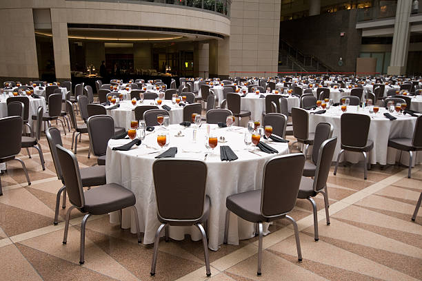 large room set up for a banquet, round tables - entertainment building stock pictures, royalty-free photos & images