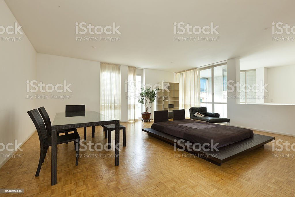 large room with double bed and table royalty-free stock photo