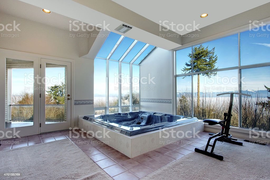 Large Room With Whirlpool And Exercise Equipment Stock Photo & More ...