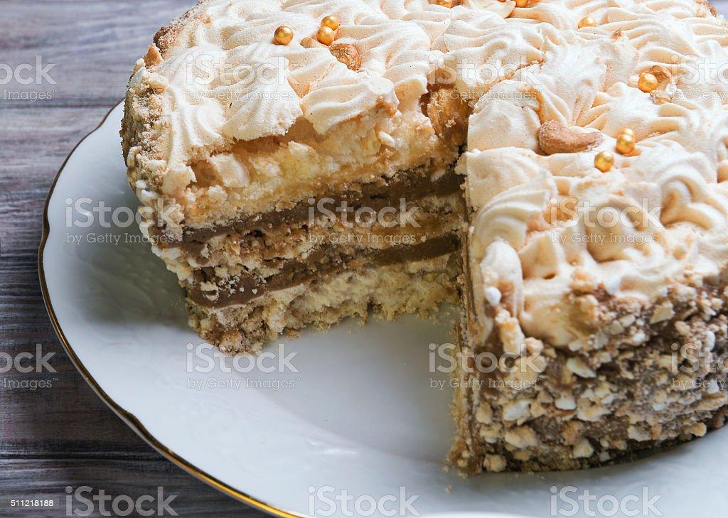 Large round air meringue cake with chocolate layer stock photo