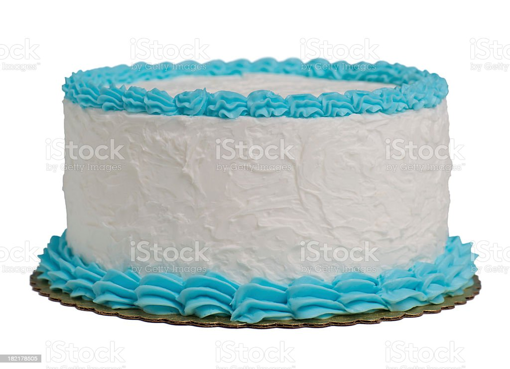 A large round cake with blue and white frosting isolated stock photo