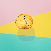 istock A large round chocolate chip cookie flies in the air 1157534770