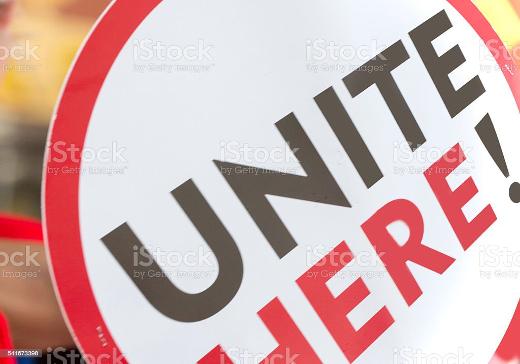Large round picket sign with words 'UNITED HERE! stock photo