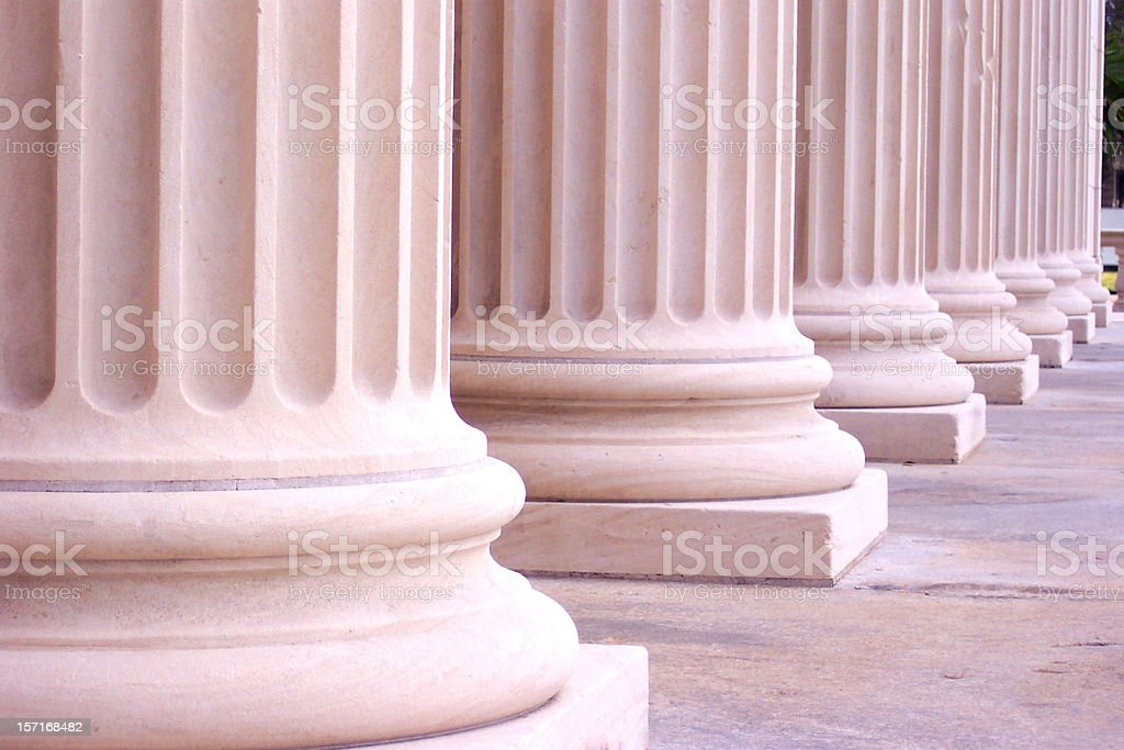Large round pink columns in a row with a square base stock photo