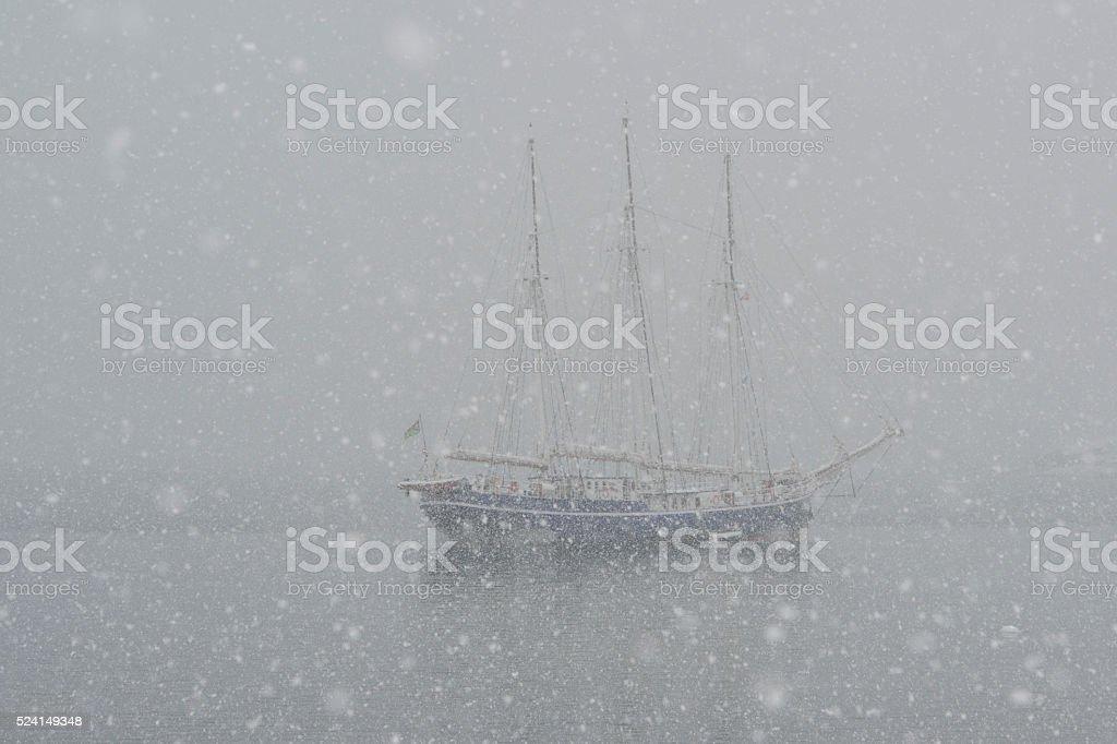 Large sailing ship in strong snowfall stock photo