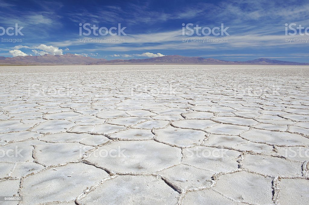 Large salt rocks with flat surface under a blue sky stock photo