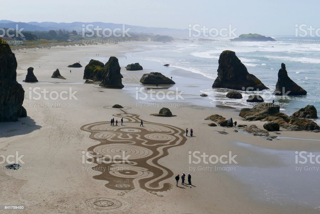 Large sand art drawing on a beach stock photo