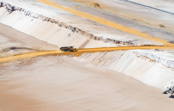 large sand dump truck HOCHNEUKIRCH, GERMANY - JULY 7, 2018: Sand dump truck transporting sand in the Garzweiler brown coal mine tagebau stock pictures, royalty-free photos & images