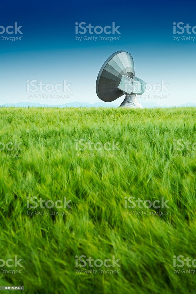 Large Satellite Dish in Green Field royalty-free stock photo