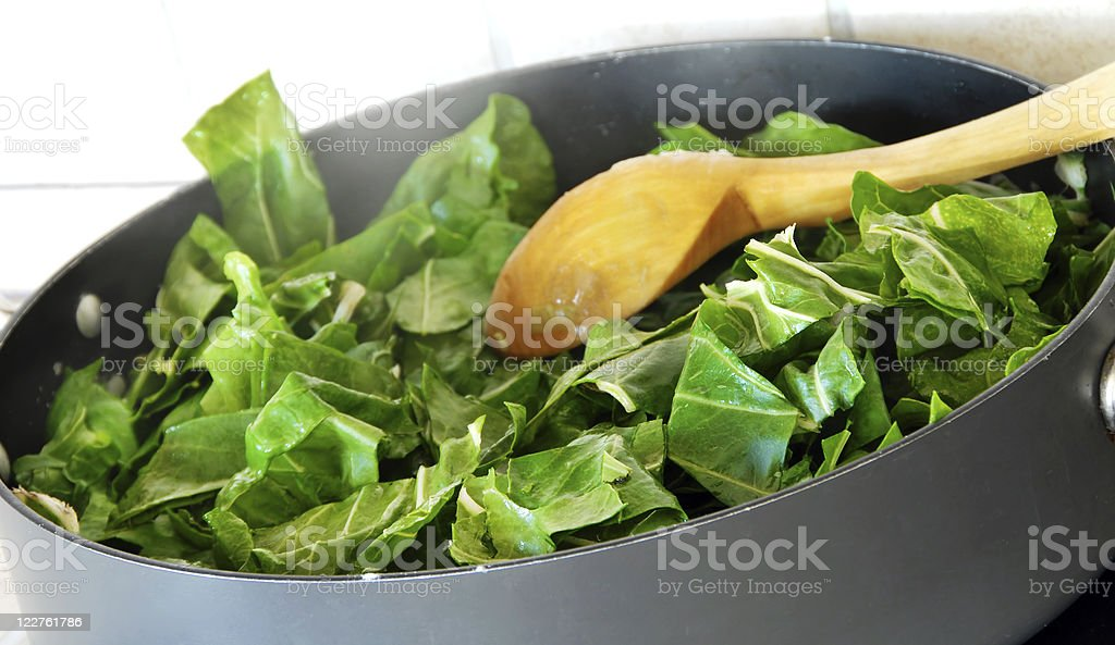 Large saucepan filled with spinach royalty-free stock photo