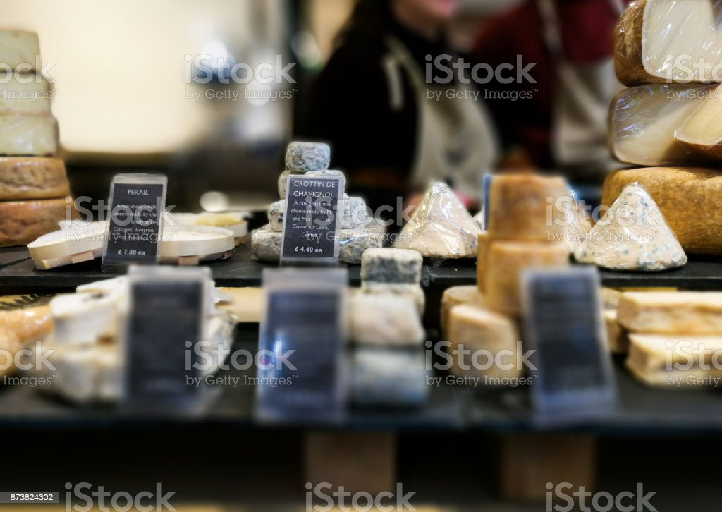 Large selection of camembert cheese, brie and other cheeses on display at Borough Market, London, UK stock photo
