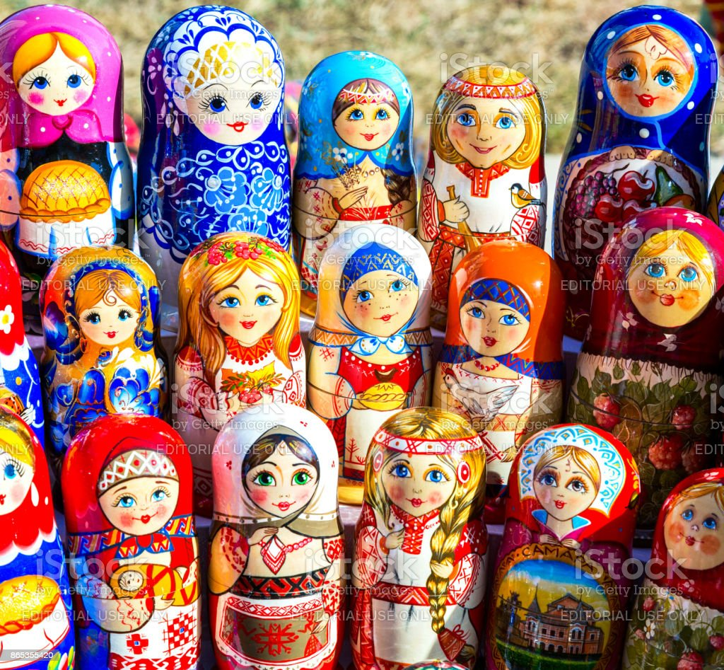 Large selection of matryoshkas Russian souvenirs at the gift shop stock photo