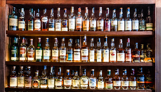 Large selection of Scottish malt whisky at the bar